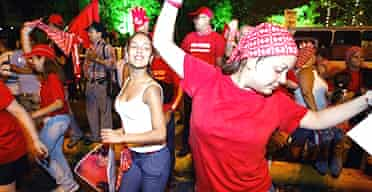Supporters of Hugo Chávez celebrate his victory in the streets of Caracas