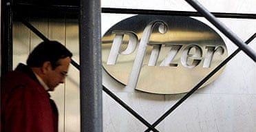 A pedestrian walks past the Pfizer Inc. headquarters building in New York