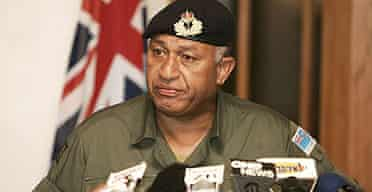 Fiji's military commander Frank Bainimarama announces he has taken control of the country from the elected government.