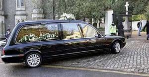 The hearse carrying Alexander Litvinenko arrives at Highgate cemetery, London