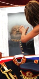 A mourner pays her last respects to Augusto Pinochet