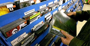 A shopper looks through records at Spillers Record shop in Cardiff