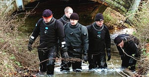 A police dive team searches a stream in Hintlesham