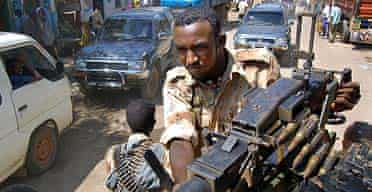 Somali government troops patrol the streets of Baidoa
