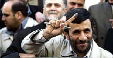 Mahmoud Ahmadinejad shows his ink-marked finger after casting his ballot