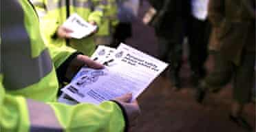 Staff at a community safety unit in Ipswich hand out leaflets
