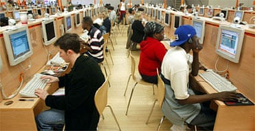 Web surfers at an internet cafe in New York