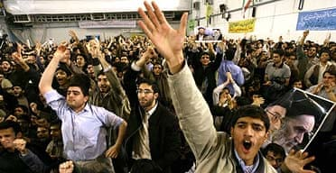 Mahmoud Ahmadinejad's backers show their support during his visit to Amir Kabir university