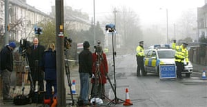 Television crews station themselves outside the police cordon near the home of Steve Wright in Ipswich