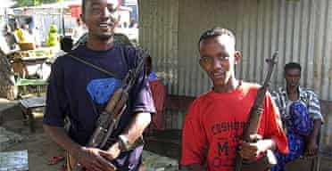 Somali militiamen hold weapons they looted after Islamists fled Mogadishu