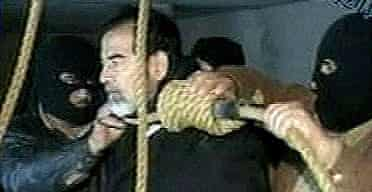 Iraqi TV footage shows Saddam with a noose around his neck