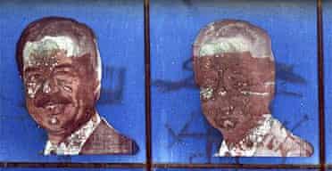 Defaced pictures of the former Iraqi leader Saddam Hussein in Baghdad, Iraq