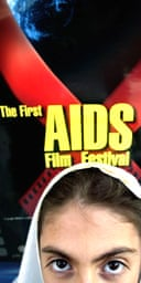 A student stands in front of a poster advertising Iran's first HIV/Aids film festival