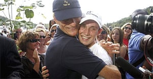 Michael Perham celebrates with his father, Peter, in Antigua