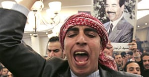 An Iraqi man shouts during a protest in Jordan against the execution of Saddam Hussein