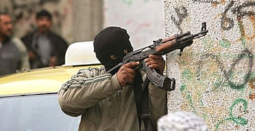 A Fatah security force fighter takes up position during a clash with Hamas gunmen in the Gaza Strip.