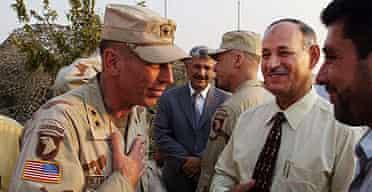 Lieutenant General David Petraeus meeting the mayor of Mosul, Iraq, in 2003.
