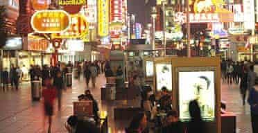 Consumers on Nanjing Road, Shanghai's major shopping street