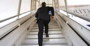 Prime Minister Tony Blair runs up the stairs to a plane as he leaves Tel Aviv airport
