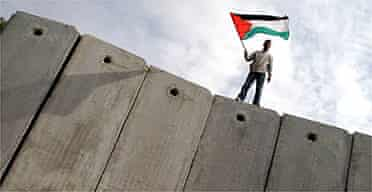 A Palestinian on the Israeli wall