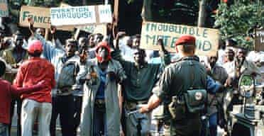Hutus celebrate the arrival of French troops in June 1994 as part of Operation Turquoise