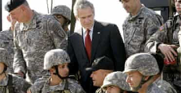 President Bush talks to troops during a demonstration of infantry training at Fort Benning, Georgia