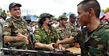 Salvatore Mancuso (left) with paramilitary soldiers near Turbo, Colombia