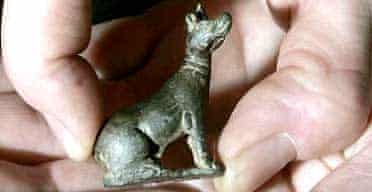 A Roman copper-alloy figurine of a hound, found by Alan Rowe as he used a metal detector on the Isle of Wight, is displayed at the British Museum in London. Photograph: Kirsty Wigglesworth/AP
