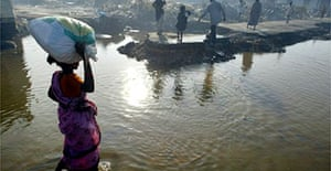 A villager returns to a fishermen's colony in Tamil Nadu that was hit by a tsunami