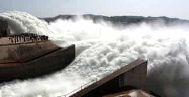Water is released from discharge tunnels at the XiaoLangdi dam on the Yellow river in central China