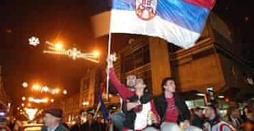 Supporters of the Serbian Radical party celebrate their victory at the polls