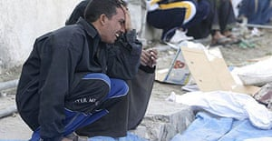 An Iraqi man mourns the death of relative who was killed in a car bomb explosion in Baghdad.