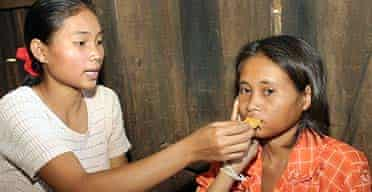 Rochom P'ngieng's supposed sister, Chanthy, tries to feed her