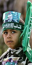 A Palestinian boy with a Hamas headband