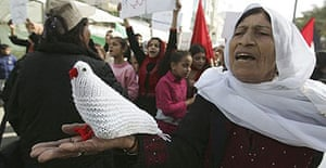 A woman holds a knitted dove in a protest calling for an end to the internal fighting between Hamas and Fatah in Gaza City.