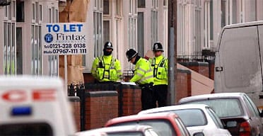 Police outside a house in Birmingham