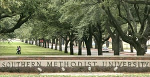 People walk across the campus of the Southern Methodist University in Dallas