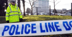 Police outside the DVLA centre in Swansea, which received a parcel bomb