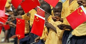 Liberian children greet China's president, Hu Jintao, on his arrival in Monrovia