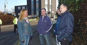 Staff from the Driver and Vehicle Licensing Agency's main centre in Swansea stand outside their office.