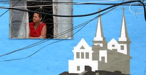 A painted house that is part of the outdoor gallery bringing hope to a Rio shantytown