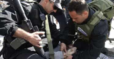 Israeli police arrest a Palestinian during clashes in the old city of Jerusalem