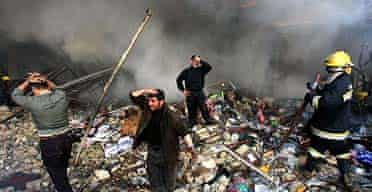 Iraqis grieve amid the rubble after a double car bomb attack in central Baghdad