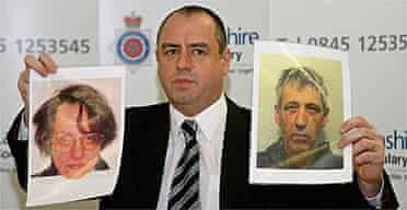 Detective Superintendent Mick Gradwell holds up photographs of David Jackson and Robert Cottage