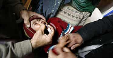 A child is given the vaccine at a Peshawar hospital