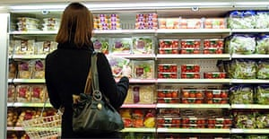 A shopper looks at food on sale in a supermarket