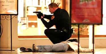 A police officer checks the crime scene in Salt Lake City