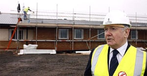 The home secretary, John Reid, visits the site of a new prison on Merseyside