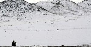 A Pakistani soldier on patrol at Lwara Fort in North Waziristan
