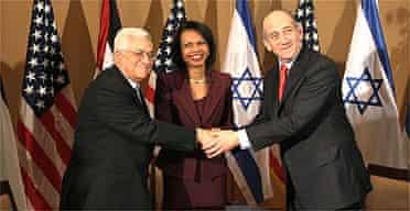 Palestinian leader Mahmoud Abbas, US secretary of state Condoleezza Rice and Israeli prime minister Ehud Olmert in Jerusalem